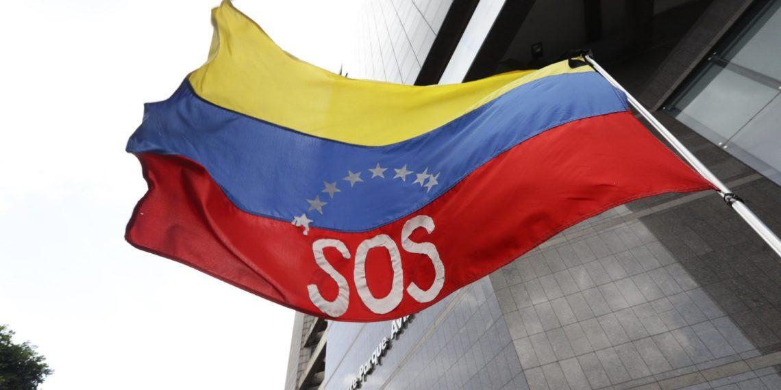 Bandera de Venezuela. Crédito: Rayner Peña | EFE
