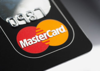 """""""Muenster, Germany - April 9, 2011: A close up macro shot of a Mastercard credit card. Mastercard is one of the biggest credit card companies in the world."""""""