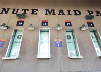 Box office windows remain closed at Minute Maid Park Wednesday, March 25, 2020, in Houston. The Houston Astros would have hosted the Los Angeles Angels in their season-opening baseball game Thursday. The start of the regular season is indefinitely on hold because of the coronavirus pandemic. (AP Photo/David J. Phillip)
